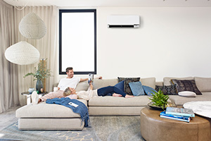 couple relaxing in lounge with split system air conditioning