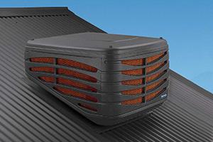 dark grey evaporative air conditioning outdoor unit on roof