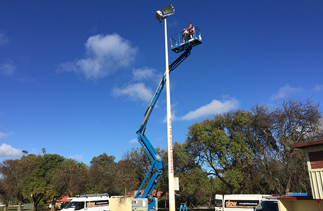 Glow installing lights at Willunga Football Oval