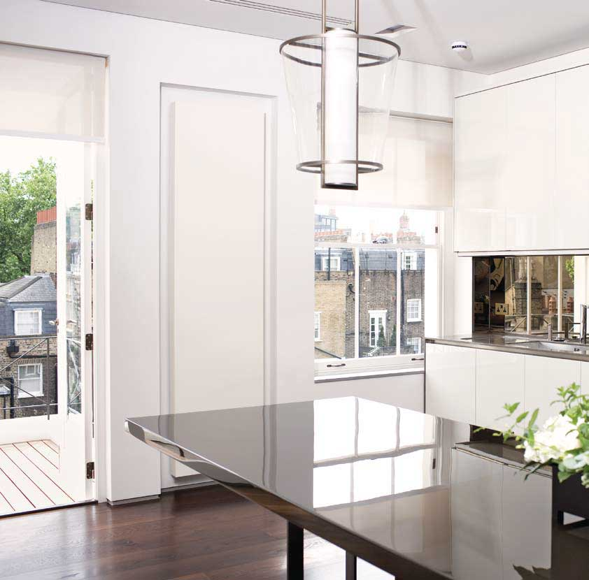 Sleek, smooth white radiator on kitchen wall
