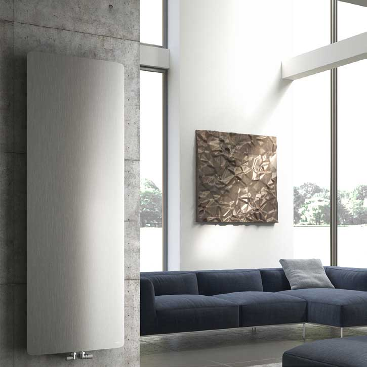 Smooth silver radiator on lounge room wall