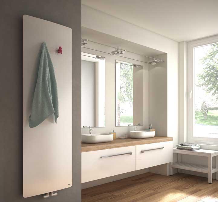 Sleek, smooth white radiator on bathroom wall
