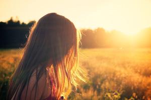 girl in glow of setting sun