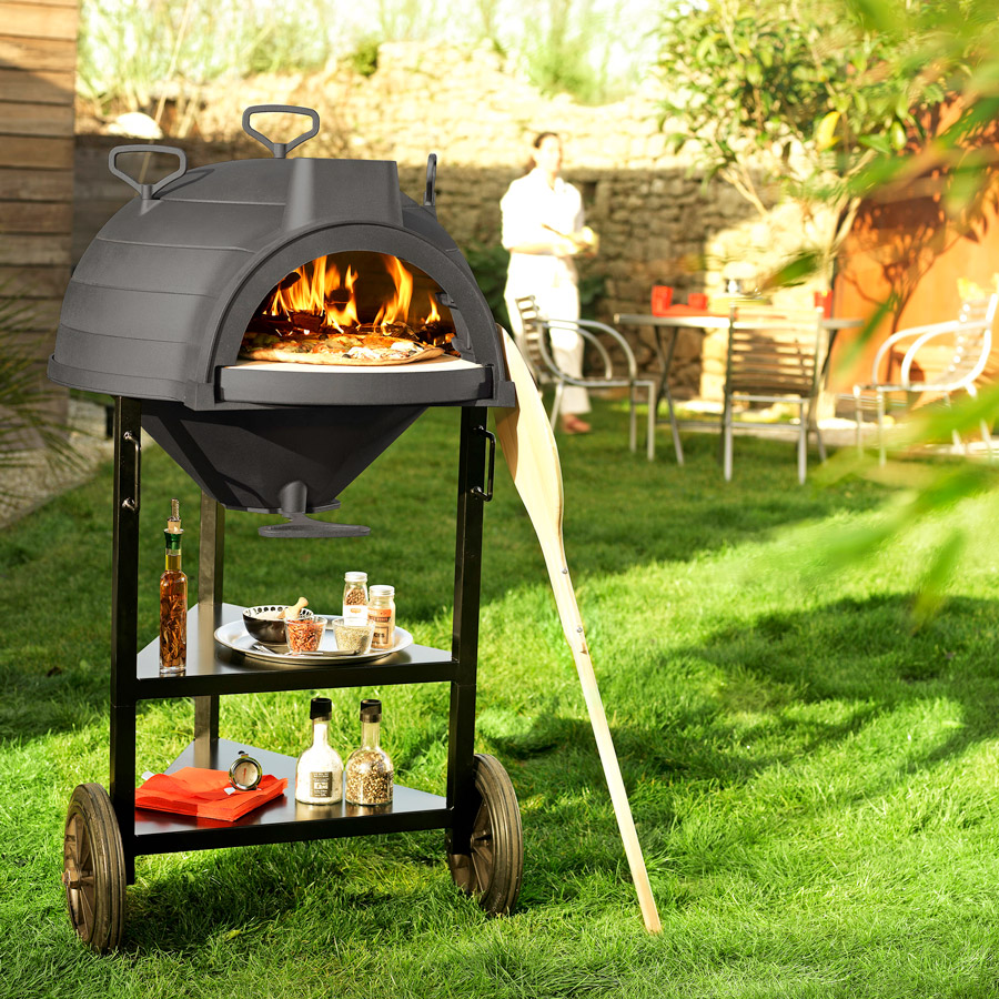 Invicta Goustaou bbq with wood fired pizza cooking inside