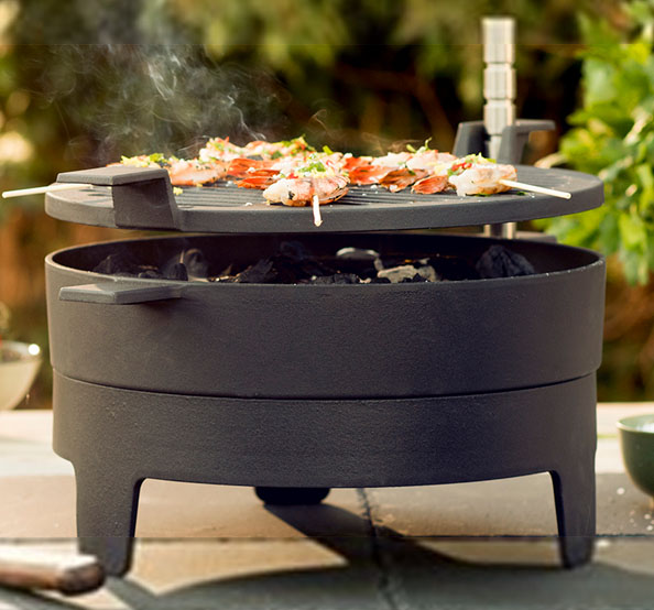 Morso Grill 71 table top with prawn skewers cooking on top