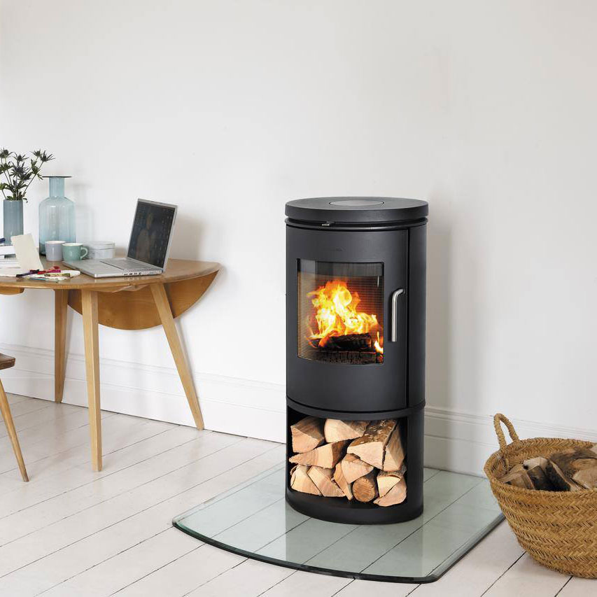 Morso 6143 wood heater with door and wood storage underneath