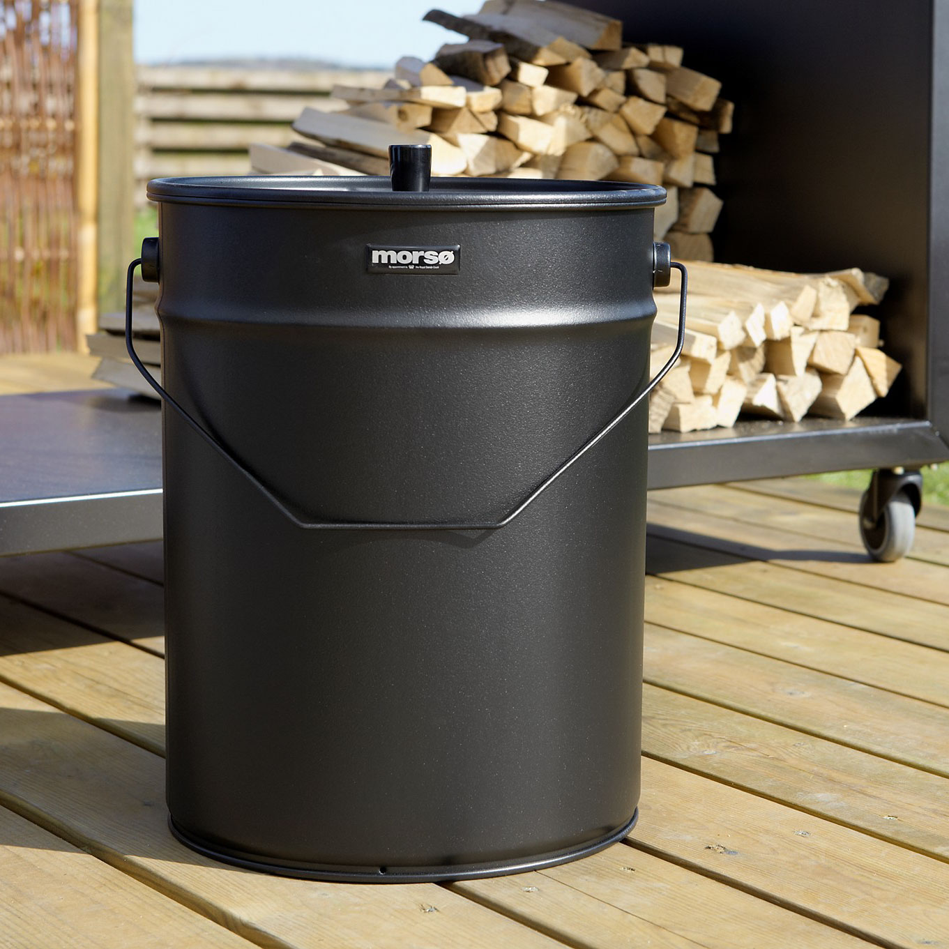 Morso ash and storage bucket in outdoor setting