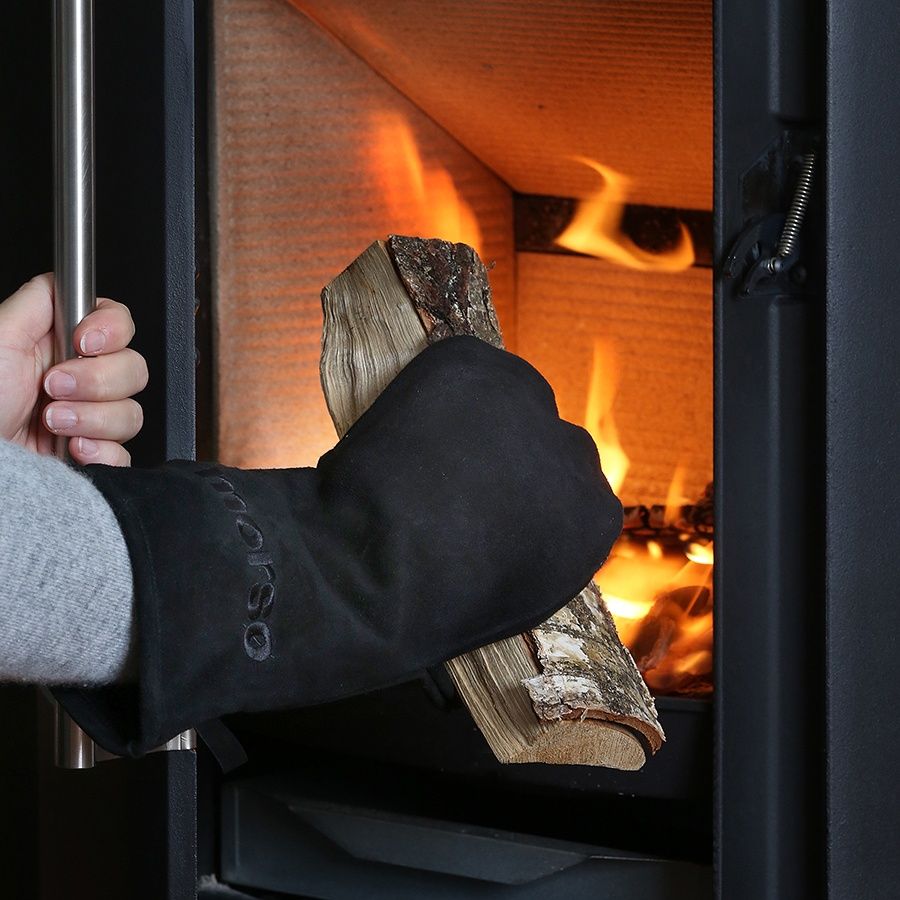 Someone wearing and using Morso heavy duty leather fire and grill glove for right hand