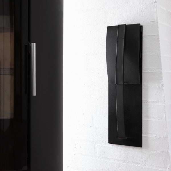 Morso Loop sleek stylish fire tool set hanging on wall