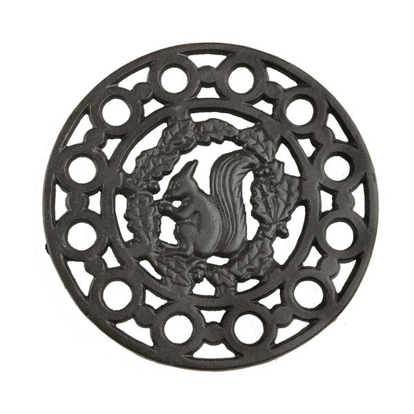 Cast iron trivet with squirrel design in the middle