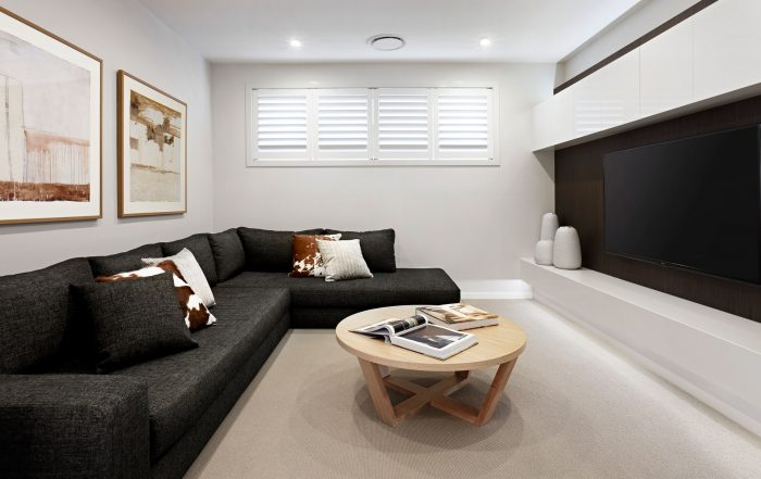 Round air conditioning ducts in the ceiling of stylish lounge room