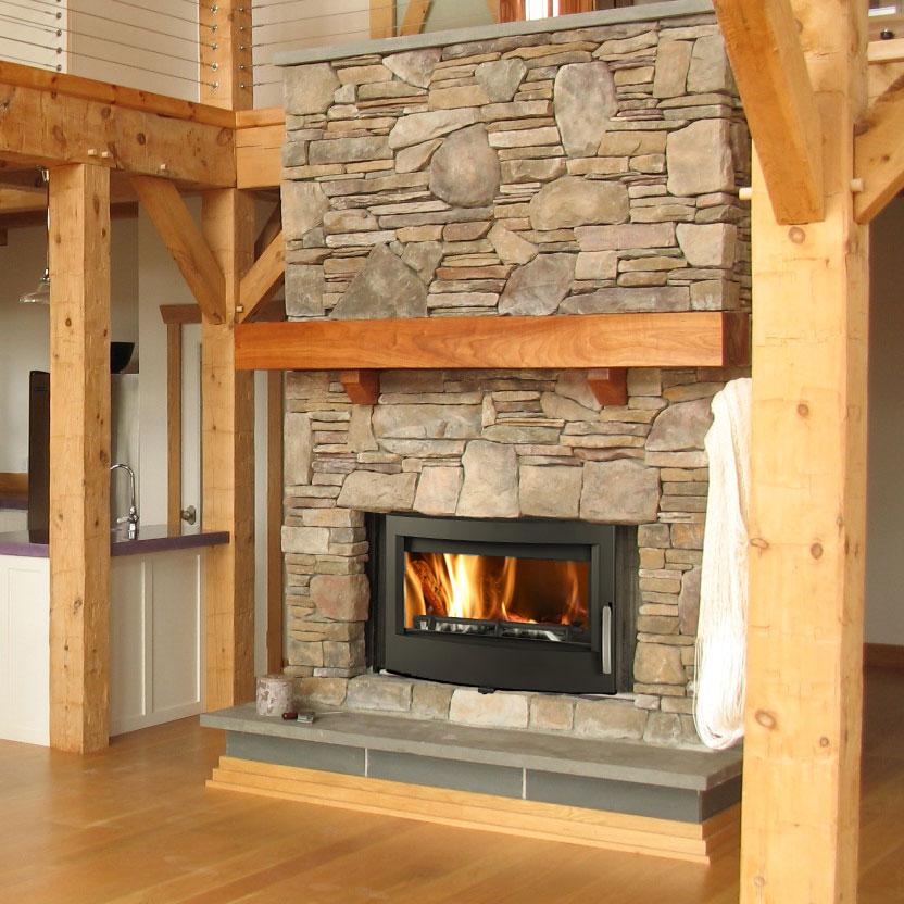 Euro Buller wood fire insert in ski chalet style interior