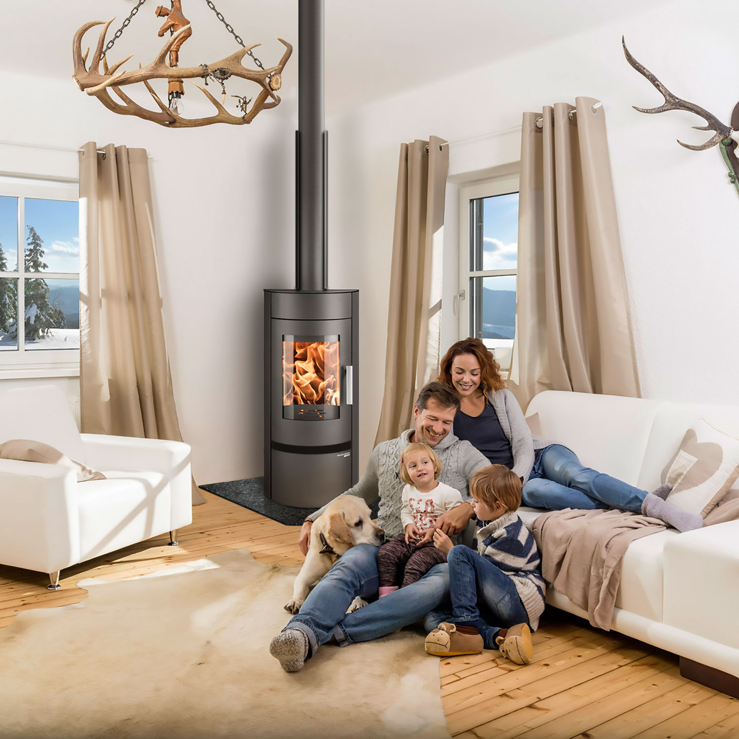 Euro Olbia wood heater in Scandinavian styled living room and family of four with dog