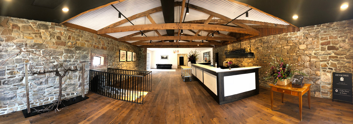 Cellar door interior with stone walls and timber raked ceiling