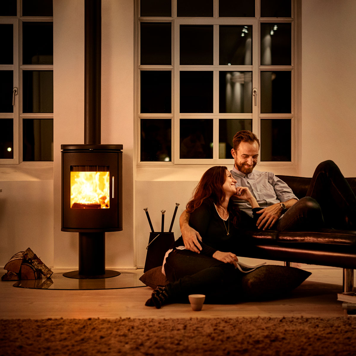 Morso 6148 wood heater in living room next to smiling couple
