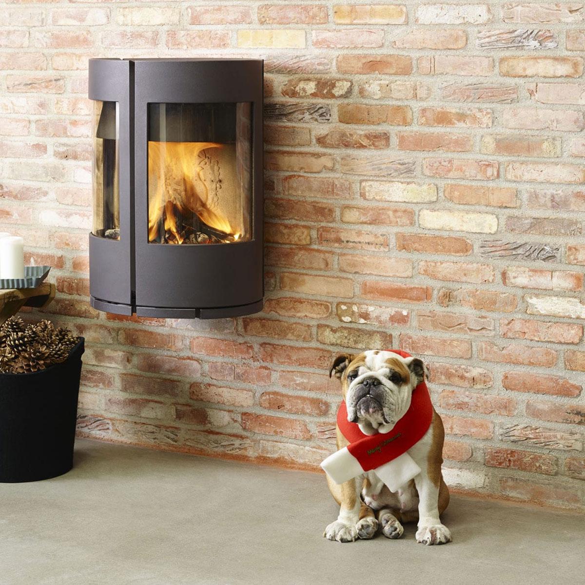 Morso 6670 wall hung wood heater with bulldog sitting next to it