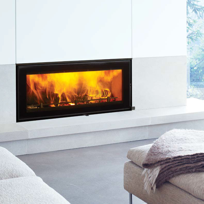 Regency Montrose inset wood heater in white stone fireplace
