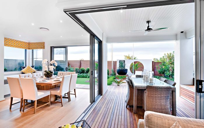Indoor and outdoor dining areas with sliding doors open
