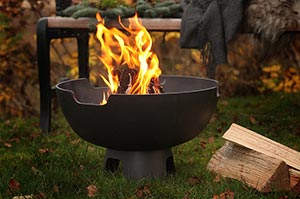 Cast iron fire bowl with flames leaping up