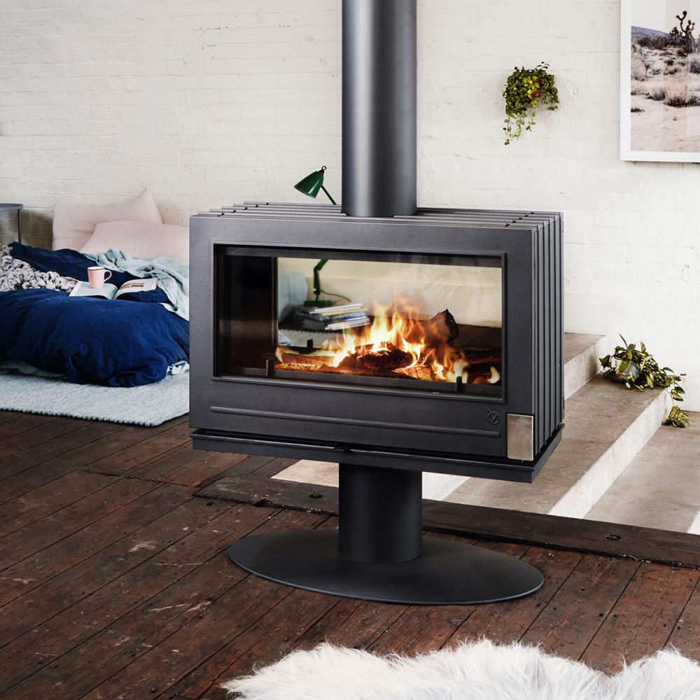 Double sided fire in cosy room with fluffy rug and timber floors
